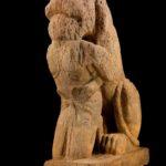 Méroé. Lion dévorant un esclave.